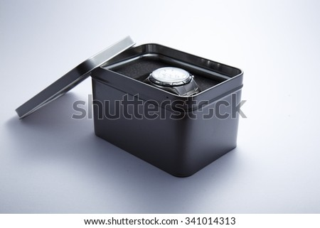luxury man clock in gift box against white background - stock photo