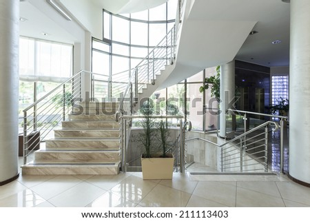 Luxury marble stairs in hotel lobby - stock photo