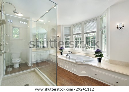 Luxury master bath with glass shower - stock photo