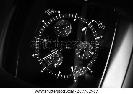 Luxury mens Chronograph Watch made of high-tech ceramics with sapphire glass. Close-up black and white studio photo with selective focus - stock photo