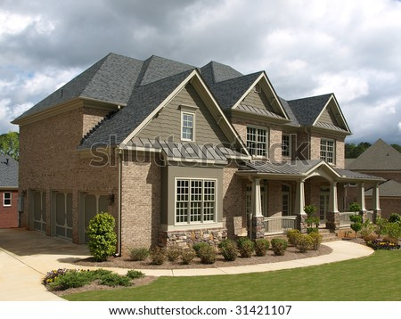 Luxury Model Home Exterior stormy weather angle view - stock photo