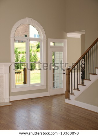 Luxury Model Home Living Room with Staircase - stock photo