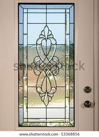 Luxury Model Home stained glass front door - stock photo