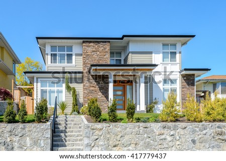 Luxury modern house with beautilful landscaping. Home exterior. - stock photo