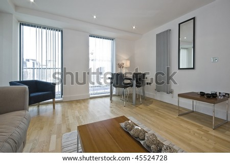 luxury modern living room with floor to ceiling windows - stock photo