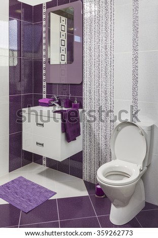 luxury modern style decorated bathroom with sink, mirror and toilet - stock photo
