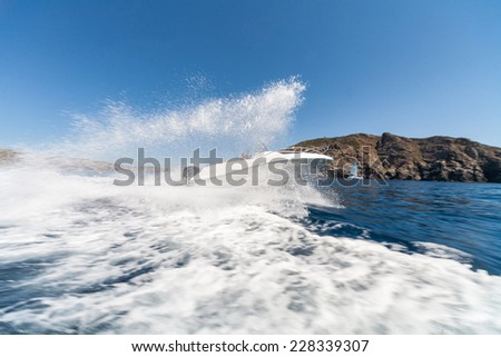 Luxury motorboat in turquoise beach of Stintino, Sardinia, Italy - stock photo