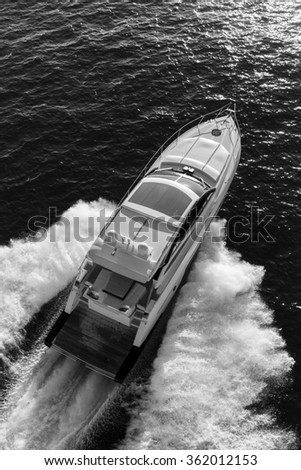 luxury motoryacht in  navigation Black and white - stock photo
