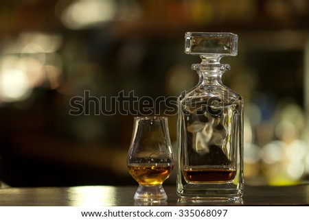 Luxury old whiskey glass on wood background. - stock photo