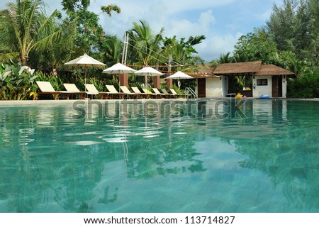 Luxury Outdoor Swimming Pool at a Tropical Resort - stock photo