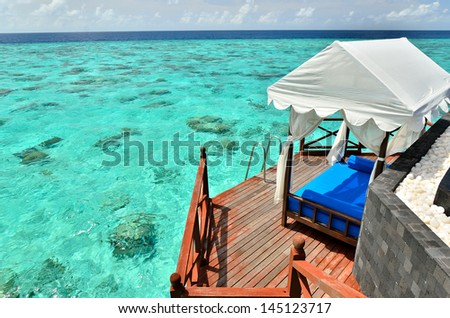 luxury overwater villa on the tropical lagoon - stock photo