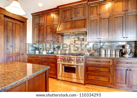 Luxury pine wood beautiful custom kitchen interior design with island and granite. - stock photo