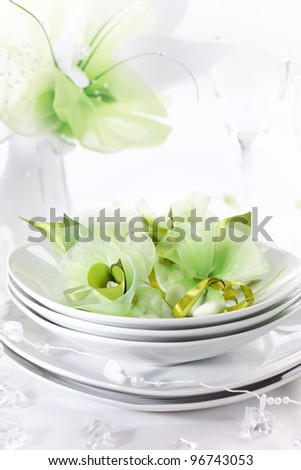 Luxury place setting for wedding in white and green tone - stock photo