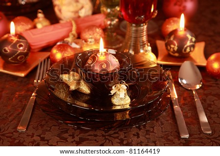 Luxury place setting in golden and brown  for Christmas - stock photo