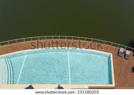 Luxury pool and river view - stock photo
