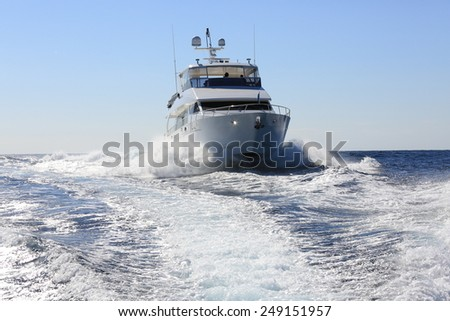 Luxury powerboat hull slicing through the waves - stock photo