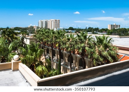 Luxury resort buildings at Sarasota Bay in Florida USA.  Architectural residential condominiums for holidays and vacation with palm trees against blue sky background - stock photo