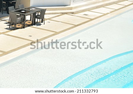 luxury resort cafe bar with swimming pool - stock photo
