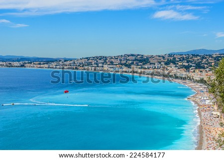 Luxury resort of French riviera. Beautiful panorama city of Nice in France. Sunny, summer day. Mediterranean sea, public beach, famous quay, palms and houses of Nice. - stock photo