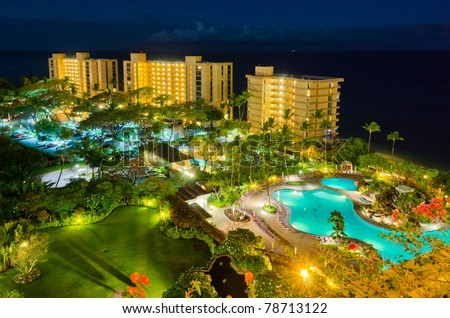 luxury resort with pool at night view - stock photo