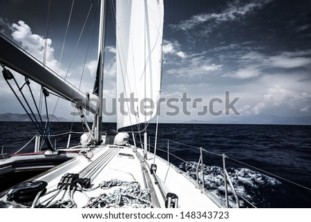 Luxury sail boat in the sea at evening, extreme water sport, yacht in action, summer transport, trip in the ocean, active holidays concept - stock photo