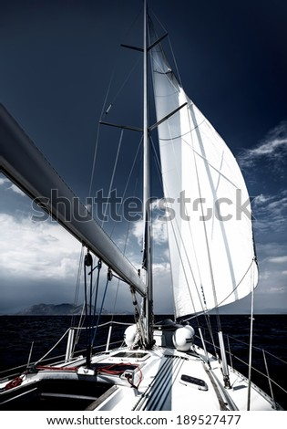 Luxury sailboat, romantic travel in the evening on sail yacht, sea cruise on expensive water transport, summer vacation and holidays concept - stock photo