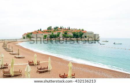 Luxury Sand Beach near Island and Resort Sveti Stefan in Budva, Montenegro. Balkans, Adriatic sea, Europe. - stock photo