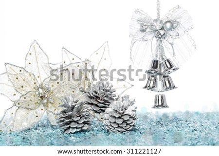 Luxury Silver jingle Bells with Snow and Pine Cone, hanging Decoration, isolated on white - stock photo