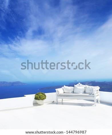 Luxury sofa and the beautiful sky - stock photo