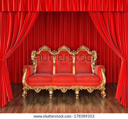 luxury sofa on stage with red curtains. - stock photo