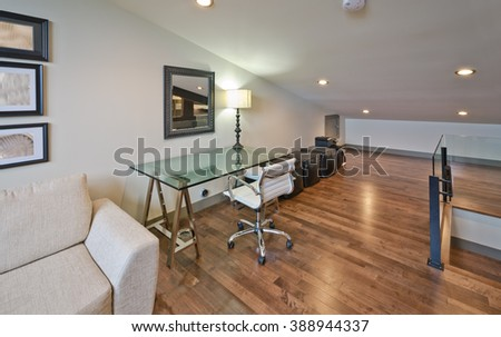 Luxury spacious modern nicely decorated den, home office in an  attic. Interior design. - stock photo
