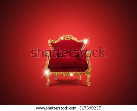 Luxury sparkling golden armchair and red velvet - stock photo