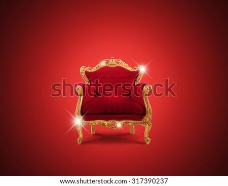 Luxury sparkling golden armchair and red velvet - stock photo