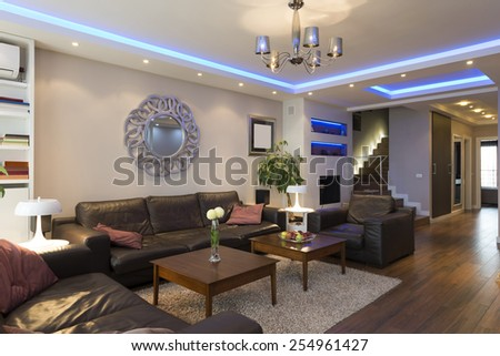 Luxury specious living room interior with modern ceiling lights - stock photo