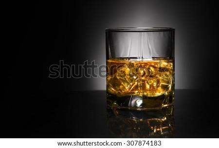 Luxury still life of whisky glass.point backgound light. Copyspace - stock photo