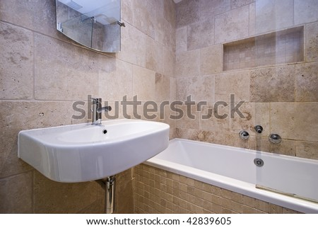 luxury stone tiled bathroom - stock photo