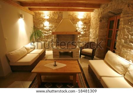 Luxury stone villa interior illuminated at night - stock photo