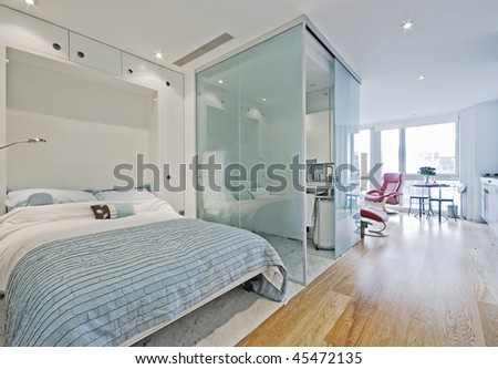 luxury studio apartment with fold down bed - stock photo