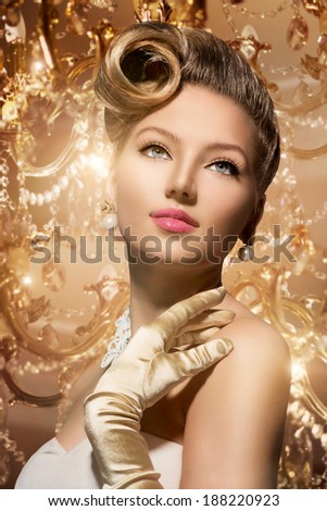 Luxury Styled Beauty Lady Portrait. Retro Woman. Beauty Fashion Vintage Style Girl with Beautiful Luxury Hairstyle, makeup, accessories. Golden Silk Gloves and dress - stock photo