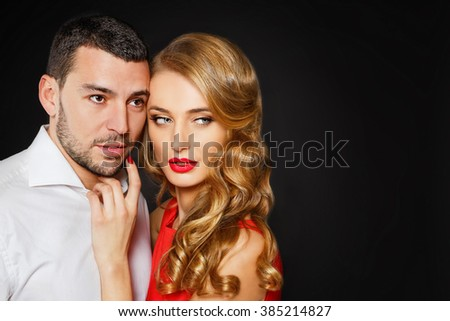 Luxury stylish couple of blonde sexy woman in red dress and handsome brunette man with bristle - stock photo