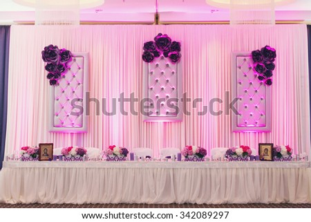 Luxury stylish wedding reception purple decorations expensive hall lights and flowers - stock photo