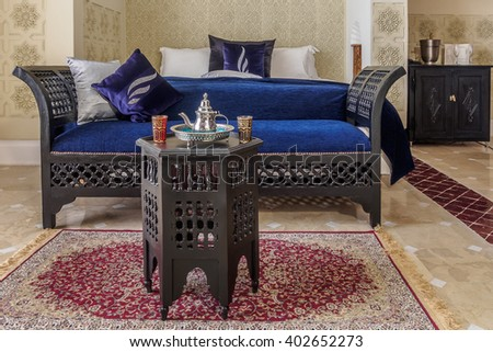 Luxury suite bedroom and couch in moroccan style - stock photo