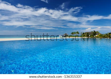 Luxury swimming pool in the tropical hotel - stock photo