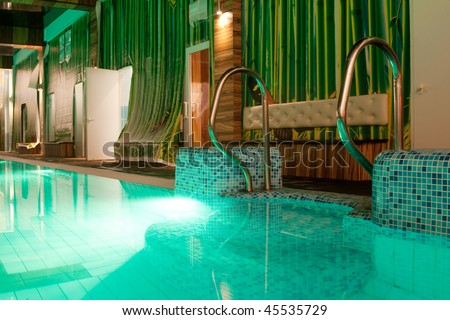 Luxury swimming pool with water in evening - stock photo