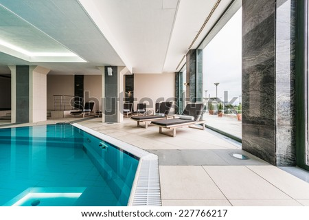 Luxury swimming pools in a modern hotel - stock photo