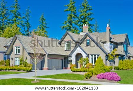 Luxury triple garage doors home in the suburbs of  North America - stock photo