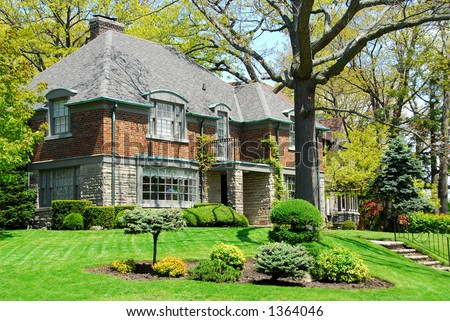 Luxury two-storey house with beautiful landscaping - stock photo