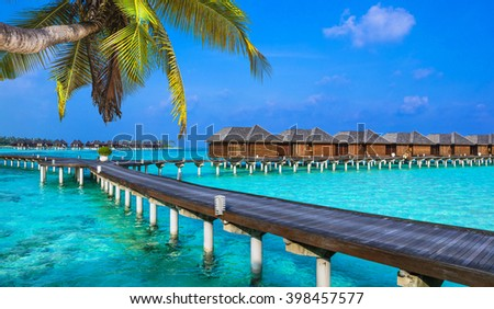 luxury vacation in Maldives - water bungalow - stock photo