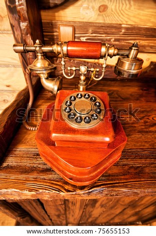 Luxury vintage interior - wooden telephone on the table - stock photo