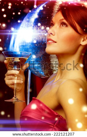 luxury, vip, nightlife, party, christmas, x-mas, new year's eve concept - beautiful woman in evening dress with cocktail and disco ball - stock photo
